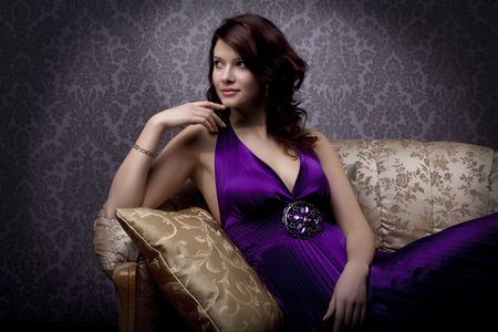 Images of beautiful glamorous girl on the couch Stock Photo