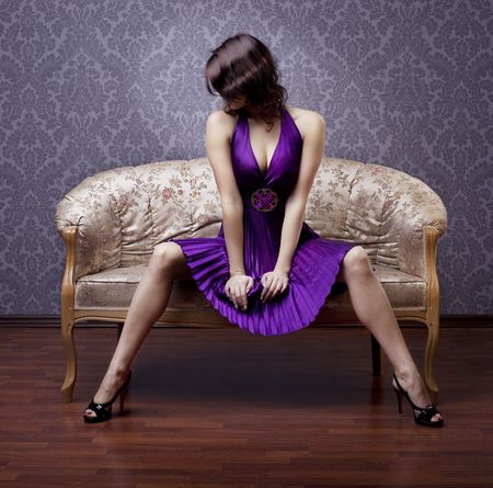 Images of beautiful glamorous girl on the couch photo