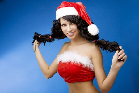 The image of the santa-girl on a blue background photo
