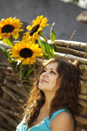 The image of the girl in the countryside with sunflowers photo