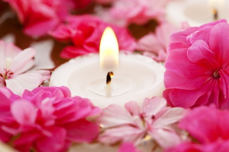Image of spa therapy, flowers in water with candles photo