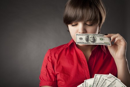 The image of a girl who has a lot of money Stock Photo - 7624185