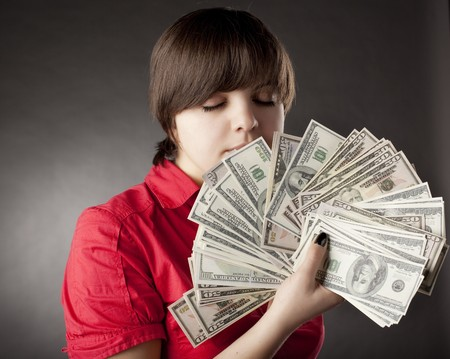The image of a girl who has a lot of money Stock Photo - 7624205