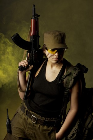 combat boots: Image of girl soldiers in the smoke Stock Photo