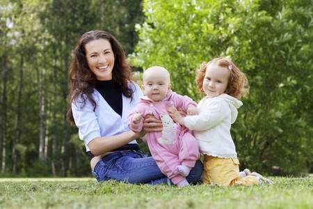 The image of mother with two kids on the field photo