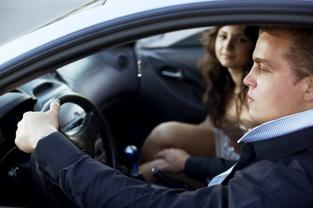 The image of a man put his hand on a womans knee in a car, harassment in the car photo