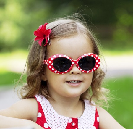 The image of a little girl in fashionable sunglasses Stock Photo - 7623445