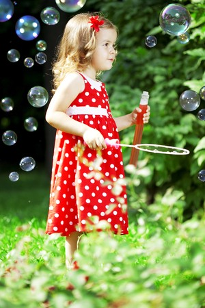 The image of a cute little girl with bubbles Stock Photo - 7624092