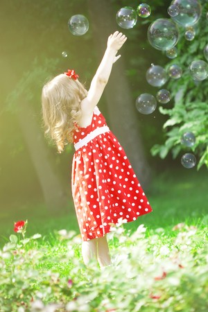 little blonde girl: The image of a cute little girl with bubbles