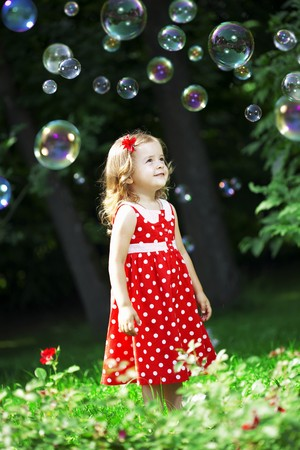 The image of a cute little girl with bubbles Stock Photo - 7624084
