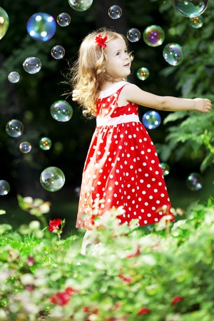 The image of a cute little girl with bubbles photo
