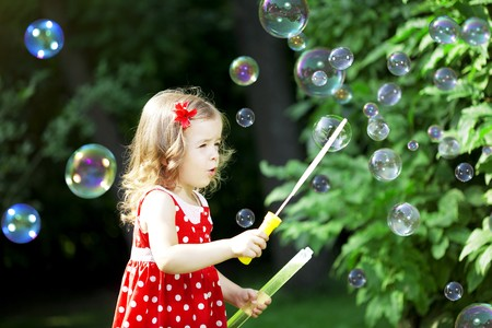 The image of a cute little girl with bubbles Stock Photo - 7624125
