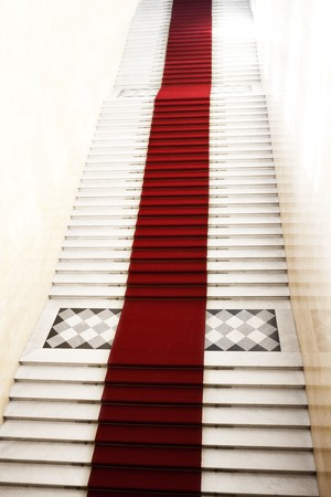 Image on the staircase with red carpet, illuminated by light photo