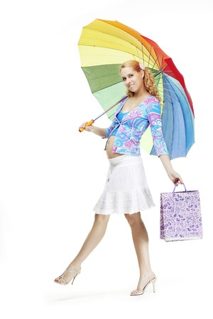 The image of a beautiful pregnant girl with a rainbow umbrella photo