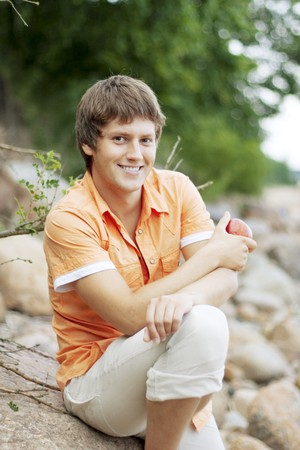 Image of portrait of a cute guy on the nature Stock Photo - 7623589