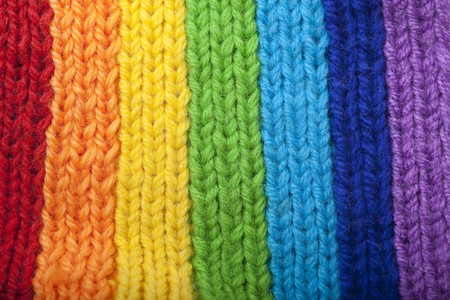 The image of a bright rainbow knitted scarf photo