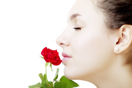 The image of a beautiful girl face close up with a rose in hand Stock Photo - 7623783