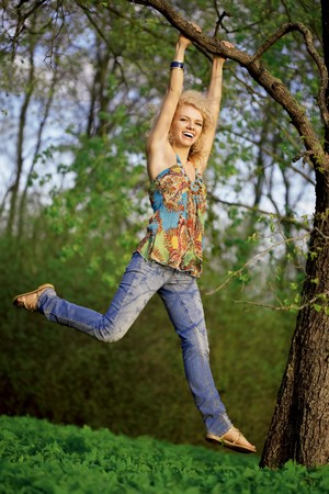 hang body: The image on the positive woman hanging on a tree and laughs