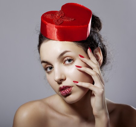 The image of a glamorous girl in an elegant hat in the form of heart photo