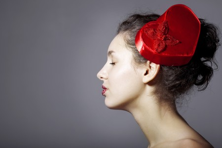 The image of a glamorous beautiful girl in an elegant hat in the form of heart Stock Photo - 7624133
