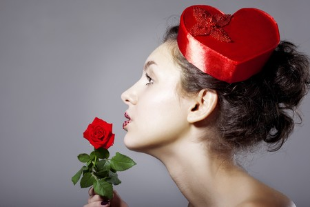 The image of a glamorous girl in an elegant hat in the form of heart Stock Photo - 7624198