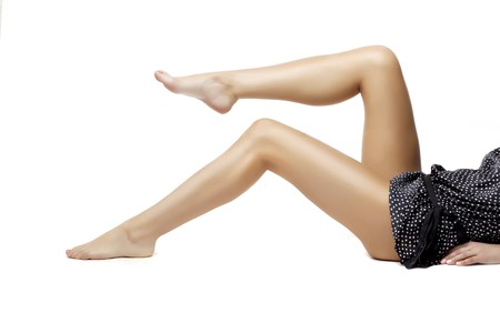 Images of beautiful female legs barefoot on a white background