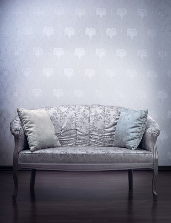 Images of the luxury gold glamorous sofa in the background of vintage wallpaper photo
