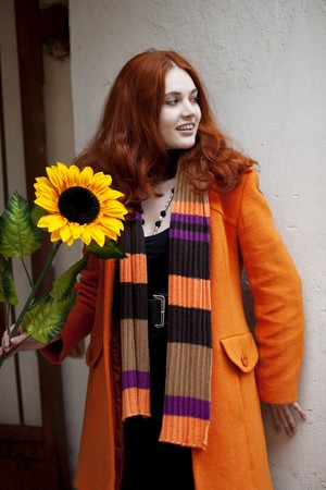 The image of a pretty girl walking with a sunflower city photo