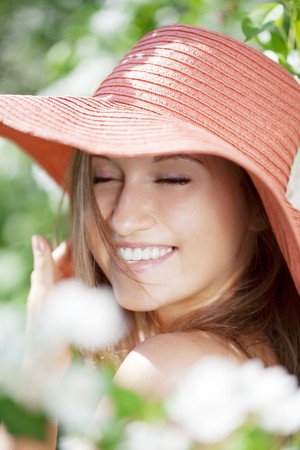 The image of a beautiful woman among flowering gardens photo