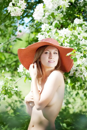 flowering field: The image of a beautiful half-naked woman among flowering gardens