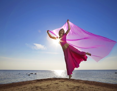 The image of a beautiful girl who jump on the beach at sunset Stock Photo - 7624008