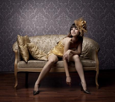 Portrait of a beautiful luxurious glamorous models in gold photo