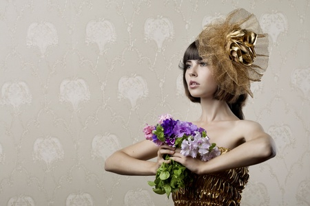 Images of the luxurious girl with flowers in their hands Stock Photo - 9038455