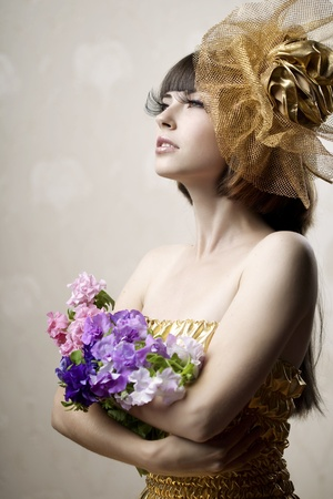 Images of the luxurious girl with flowers in their hands photo