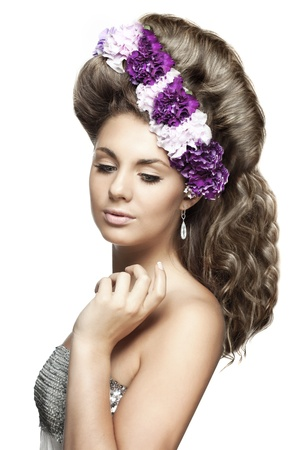 The image of girl with flowers in a beautiful hairstyle Stock Photo - 9038333