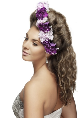The image of girl with flowers in a beautiful hairstyle Stock Photo - 9038376