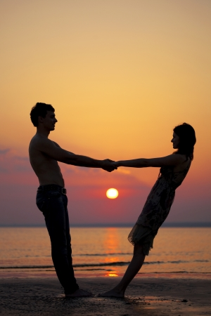 The image of two people in love at sunset Stock Photo - 9038106