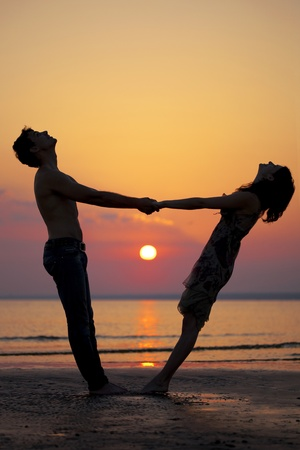 The image of two people in love at sunset photo