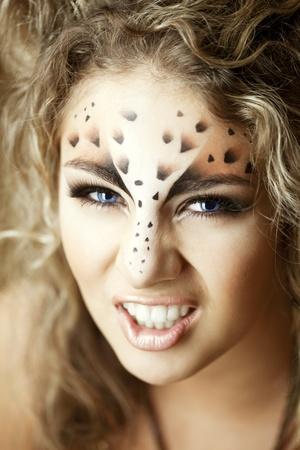 Image of luxury girl, like a leopard photo