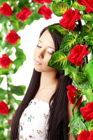 The image of a beautiful girl with bright make-up among the roses Stock Photo - 9038172