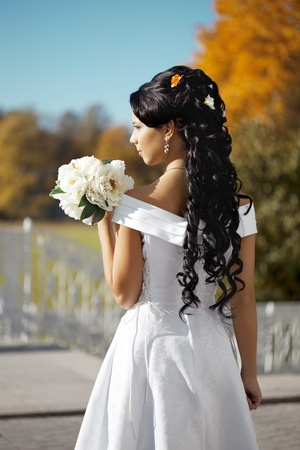 The image of a beautiful bride in the autumn park Stock Photo - 9038380