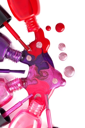 polish: Image of bright-colored nail polish  spilling from bottles
