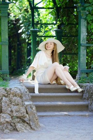 The image of a beautiful girl in a summer park photo
