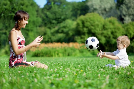 Image of family, mother and son playing ball in the park. Stock Photo - 10705335