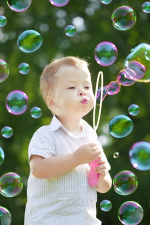 The image of the child blow bubbles photo