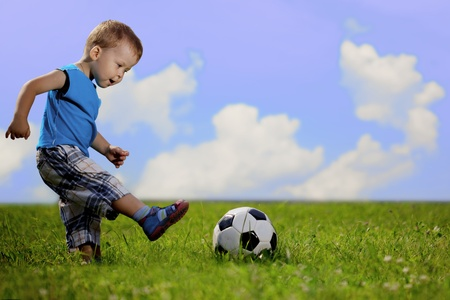 women playing soccer: Image of family, mother and son playing ball in the park. Stock Photo