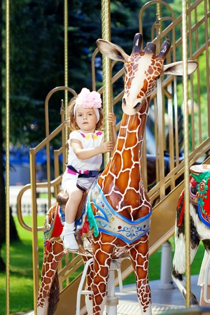 merry go round: The image of a girl riding on a carousel