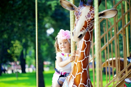 The image of a girl riding on a carousel Stock Photo - 11527490