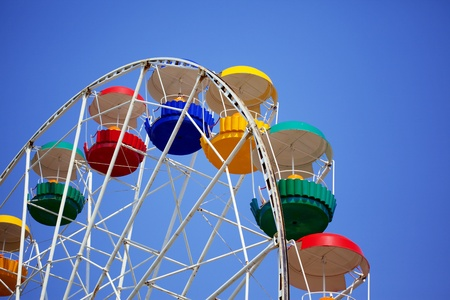 Image of bright colored carousel. photo