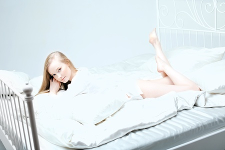 The image of a girl lying on the bed photo